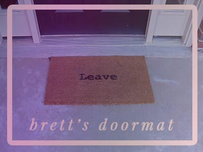 Brett's doormat says, ``Leave.``
