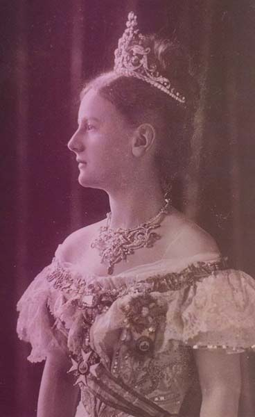 Queen Wilhelmina of the Netherlands in 1901, wearing a court dress, an ornate diamond necklace, and a tall tiara over upswept hair.